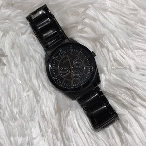 Black fossil watch with silver detail face